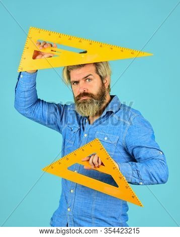 Math Graphic Tools. Ready For Engineering. Tool For Graphics. Mature Bearded Man Hold Triangle Ruler