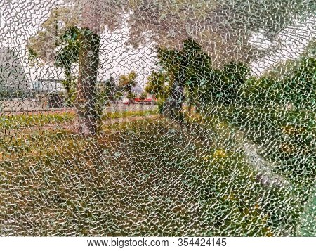 Glass Window Completely Cracked, Scenery Shining Through, Shattered Fragments, Abstract Background