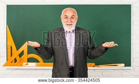 Knowledge Concept. Information Is Everywhere But Wisdom Is Scarce. Man Bearded Tutor In Classroom. F