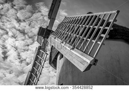 A Black And White Picture Of The Sailes Of An Old Windmill In Ireland