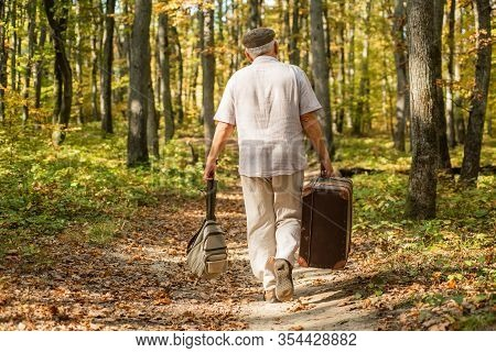 Retirement Travel And Hobbies. Always Have Bag Ready To Go. Elderly Carry Travel Bag. Old Man Travel