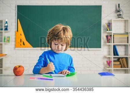 After School Teaching. Happy School Kids At Lesson. Child Tutoring. Elementary School Classroom. Bac