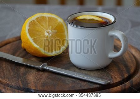 A Cup Of Black Coffee With A Slice Of Lemon On A Grey Tablecloth, Selective Focus