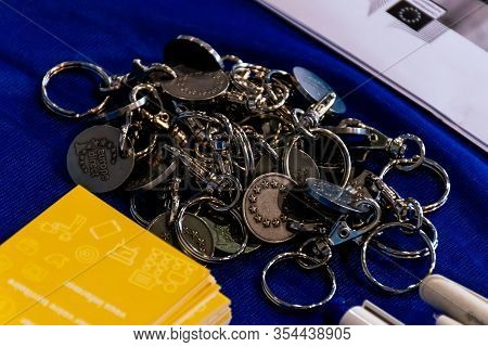 Draguignan, France - March 3, 2020: A Pile Of Key Chains With The European Union Stars On A Table Wi