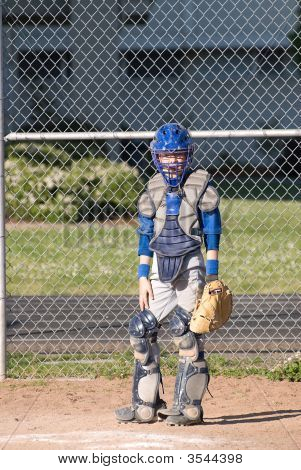 A Young Boy In Catchers Uniform.