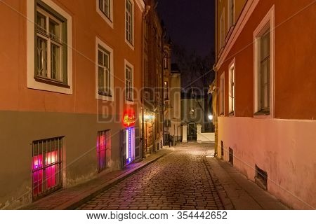 Tallinn, Estonia - January 12, 2018: Night Winter View Of The Walls Of The Old Buildings In The Hist