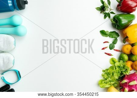 Healthy Lifestyle, Food And Sport Concept. Athlete's Equipment And Fresh Fruit On White Background.