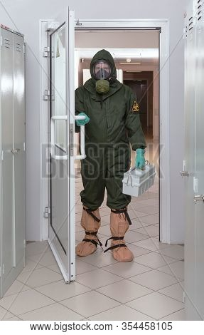 Men With Box For Transporting Samplesin In A Biohazard Protective Suit. Protection Against Sars-cov-