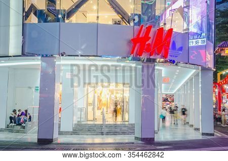 Taipei, Taiwan - May 15, 2018: H&m Store At Night In The Ximending Pedestrian Area. H&m Is A Swedish