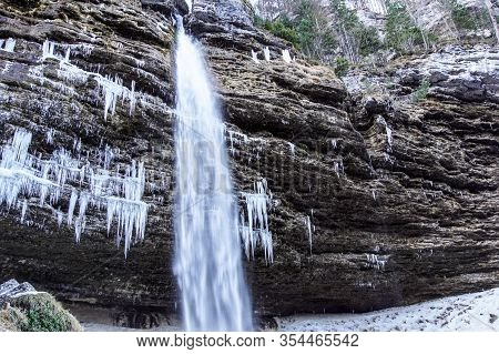 Frozen Ice Waterfall, Winter Landscape. Ephemeral, Cold And Winter Concept. Valganna Waterfall, Nort