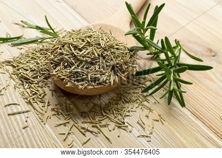 Pile Of Dry Rosemary On Wooden Background Top View