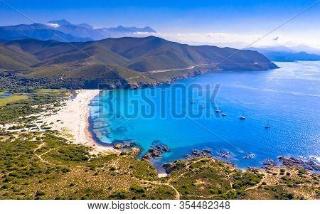Aerial View Over Ostriconi Beach On North East Coast Of Corsica Island Near Ile Rousse, Calvi, Franc
