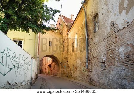 Narrow Streets Of The Old Town Of Vilnius, One Of The Largest Surviving Medieval Old Towns In Northe