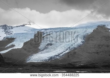 Vatnajoekull Glacier In Iceland Spiky Crevasse In Black And White With Blue Accent Colored Ice