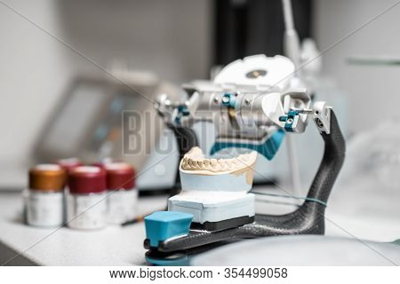Dental Articulator With Jaw Model On The Table At The Laboratory