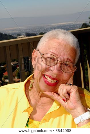 Elderly African American Woman Sitting Outdoors