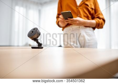 Close-up On Wireless Ip Camera At The Table At Home. Concept Of Managing Security Devices Remotely F