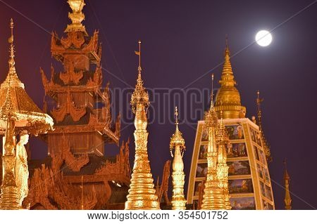 Full Moon Over Golden Stupas At Shwedagon Pagoda