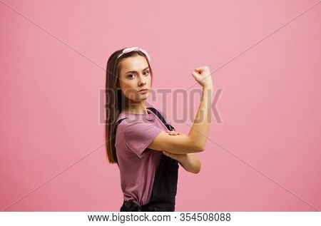 Yes, You Can, A Strong And Independent Woman, An Image From A Poster. The Girl Shows The Biceps