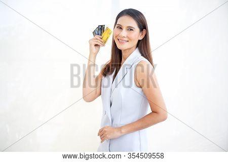 Happy Asian Woman Smile At Credit Card, Hold Shopping Reward Bonus On Isolate White Background. Stud