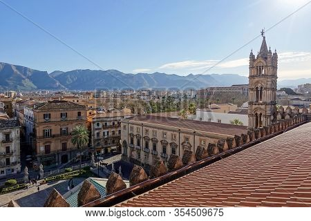 Palermo, Sicily - February 8, 2020: The Bell Tower And The Roof Of Palermo Cathedral With Mountains