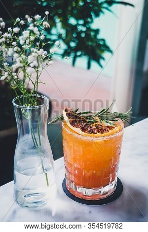 Blood Orange Margarita Mezcal, Homemade Blood Orange Soda, Lime Juice, Worm Salt.