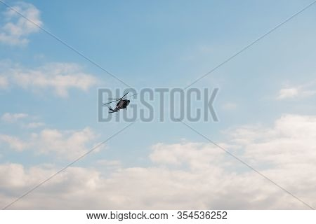 Modern Helicopter Flying In The Blue Sky.flying Transport Helicopter.the Aircraft, The Black Helicop