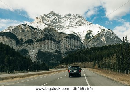 Road Through The Canadian Rockies, Surrounded With Rocky Mountains. Banff National Park, Alberta, Ca