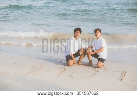 Young Asian Couple Gay Smiling Romantic Drawing Word Text Love Together On Sand In Vacation, Homosex