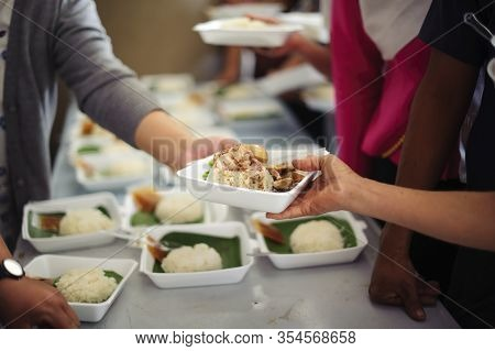 Concept Of Begging Food : Beggar Begs Food From Donors: Concept Of Poverty In Asian Society