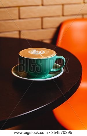 Cappuccino. Cup Of Cappuccino Coffee On Orange Background