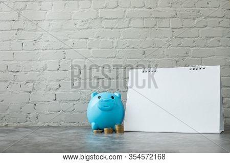 Blank Calendar Paper With Piggy Bank, Concept Of Financial.