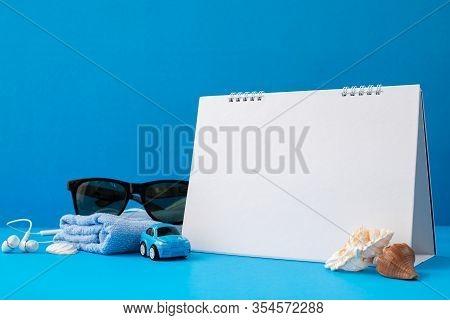 Traveller Accessories In Summer On Blue Background.