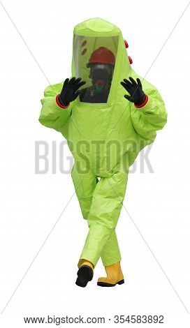 Person With Yellow Protective Suit And Special Silicone Rubber Boots To Avoid Contagion With Viruses