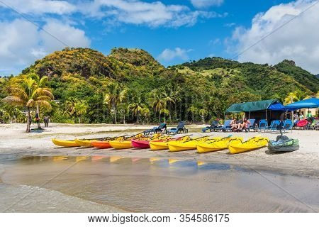 Buccament Bay, St Vincent And The Grenadines - December 19, 2018: Kayaks Lie On The Buccament Bay Be