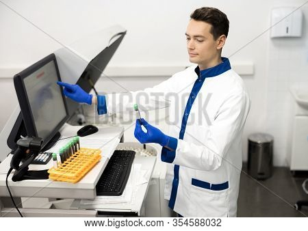 Handsome Male Researcher Doing Biochemical Blood Test In Lab