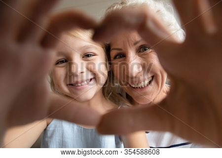 Self-portrait Picture Of Smiling Grandmother And Little Granddaughter