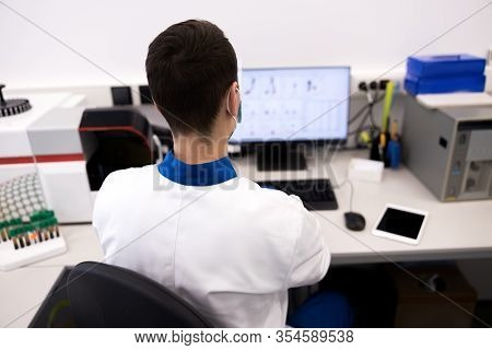 Male Researcher In Lab Coat Working In Science Laboratory