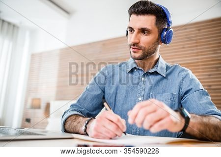 Handsome Male Working Online At Home Stock Photo