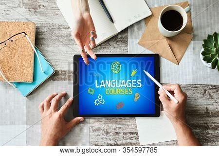 Tablet With Languages Courses Text And Icons On Screen. English Learning Online. Education Concept.