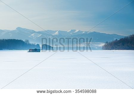Beautiful Landscape, Lake And Houseboat With Mountain In Background.