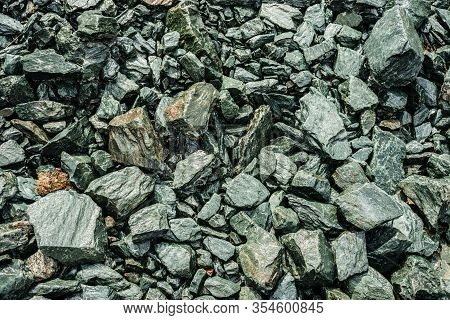 Nature Background Of Chaotic Pile Of Stones. Natural Backdrop Of Random Boulders. Combe Rock Close-u