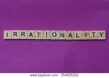 Word Irrationality From Small Gray Wooden Letters Lies On A Lilac Background