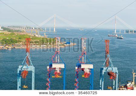 crane terminal at russian port Vladivostok and new bridge to Russky Isle
