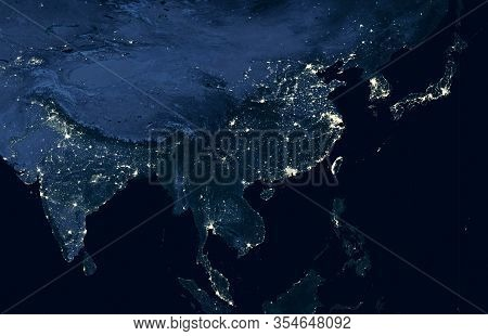 Earth At Night, View Of City Lights Showing Human Activity In India, China, South Korea And Japan Fr
