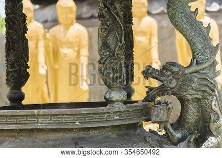Foz Do Iguacu, Parana / Brazil; Dec 17, 2017: Chen Tien Buddhist Temple Detail, Sculpted Metallic Dr