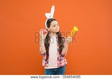 You Are My Honey Bunny. Little Kid In Rabbit Costume Hold Carrot. Spring Holiday Celebration. Easter