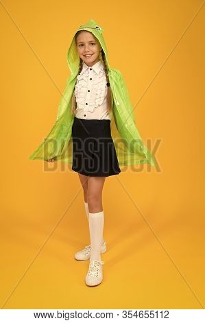 Schoolgirl Hooded Raincoat Going To School. Waterproof Clothes. Kid Girl Happy Wear Raincoat. Rain I