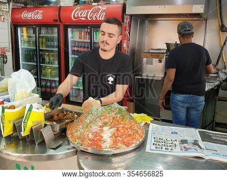 Afula, Israel. February 22, 2020. Israeli Men Making Falafel In A Local Falafel Shop. Israeli Cuisin