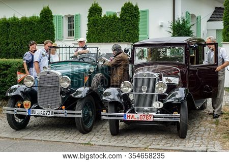 Welfenallee, Berlin, Germany - June 16, 2018: Car Owners In Historical Costumes At Their Ford And Wa